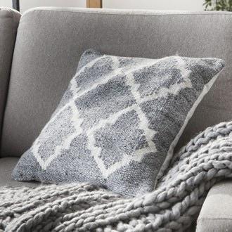 Coussin en laine grise et motif naturel 45x45cm