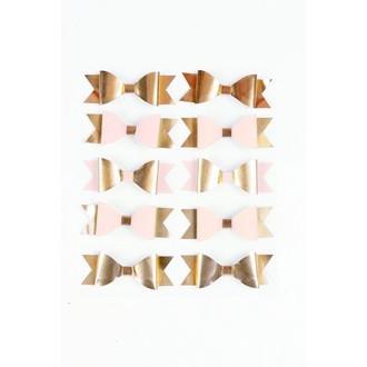 Marques-place nœuds papillons rose et or en sachet de 10