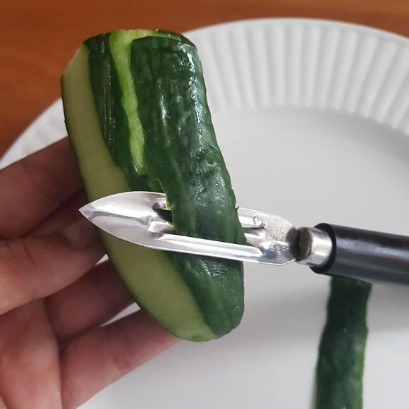 Pela verdure professionale con manico ergonomico in plastica