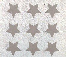Achat en ligne 9 écussons étoiles thermocollants argent 1,9x1,9mm