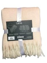 Achat en ligne Plaid effet mohair à franges rose make up Lena 125x150cm