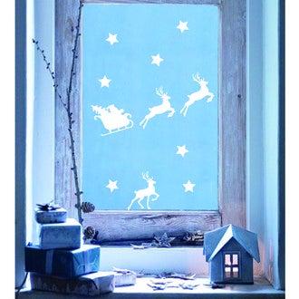 Sticker vitre blanc père noël traineau 25x35cm